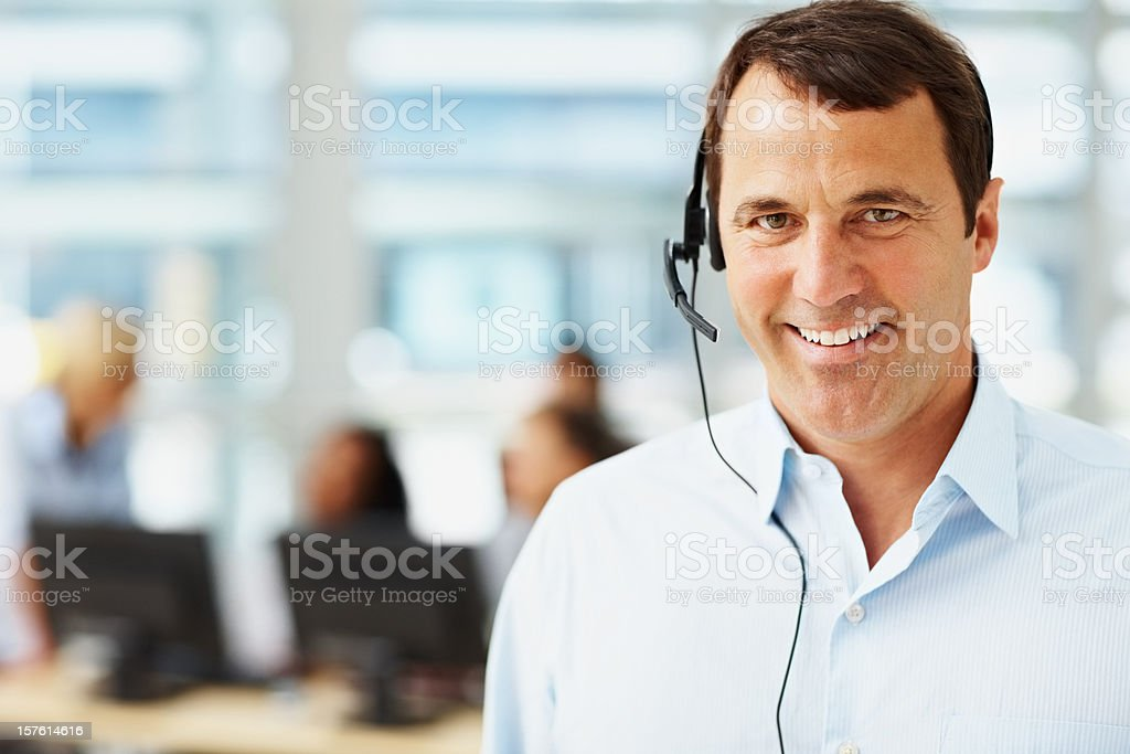 Happy mature business man using a headset royalty-free stock photo