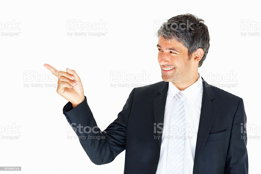 Happy mature businessman pointing at copy space royalty-free stock photo