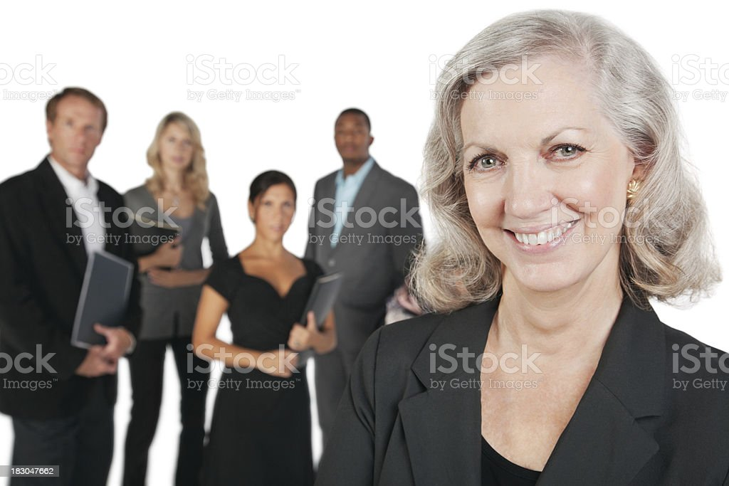Happy Mature Businesswoman With her Business Team royalty-free stock photo