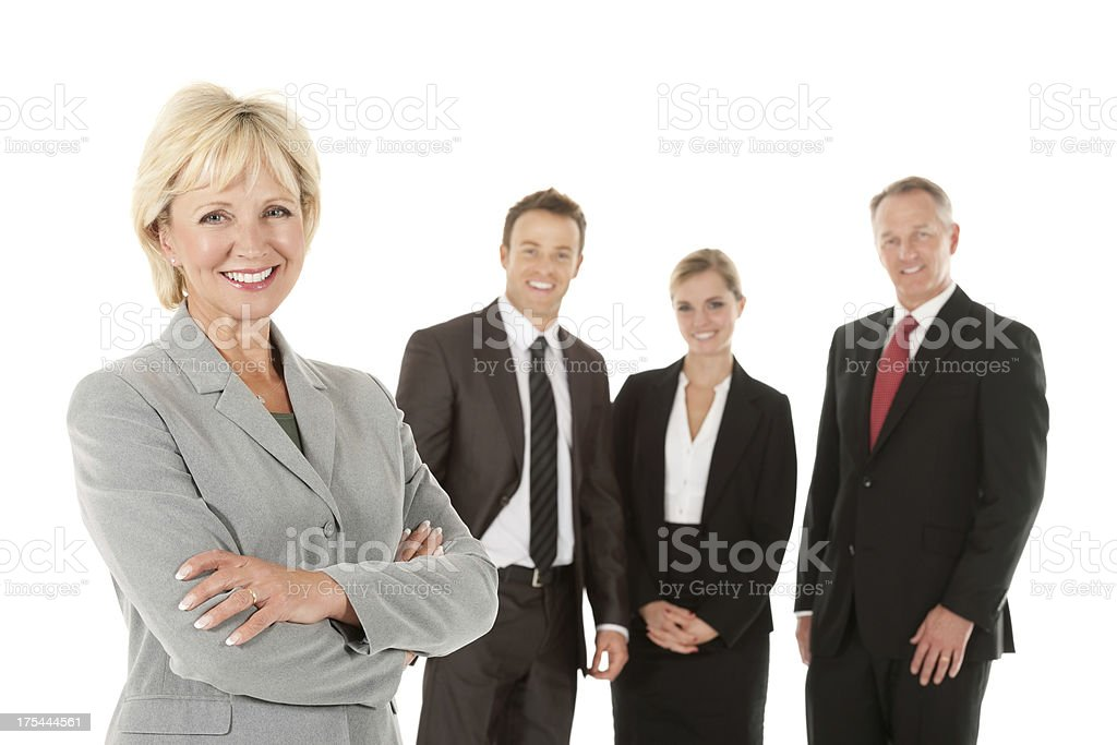 Happy Mature Businesswoman With Team royalty-free stock photo