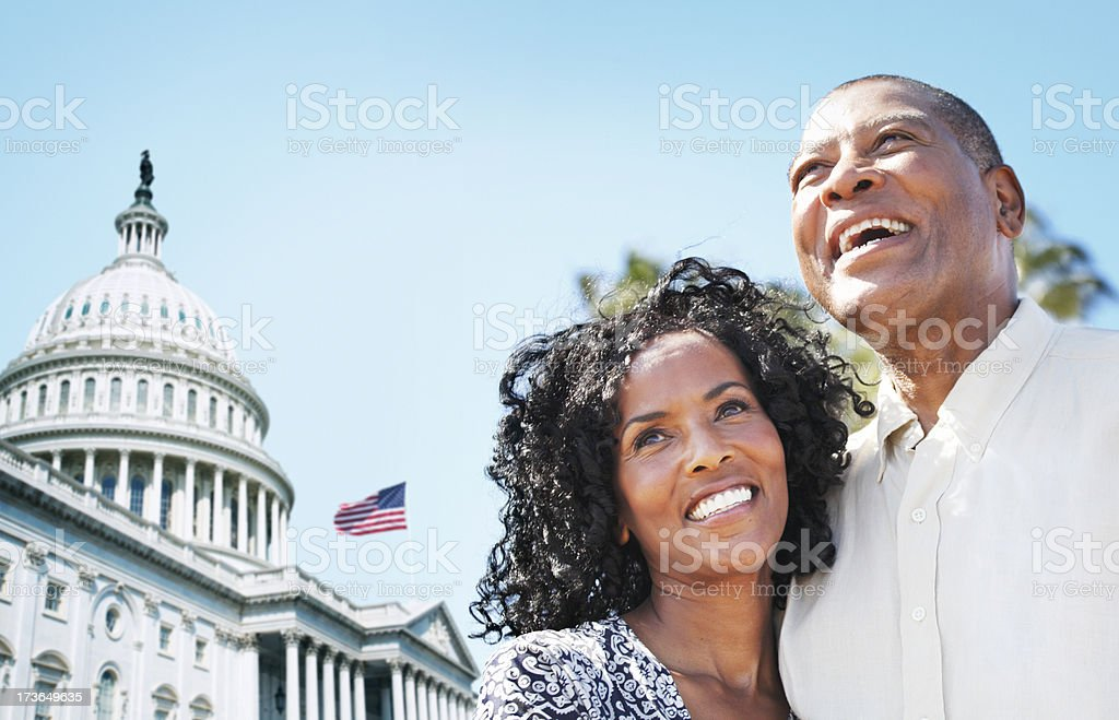 Happy mature couple by The Capitol royalty-free stock photo