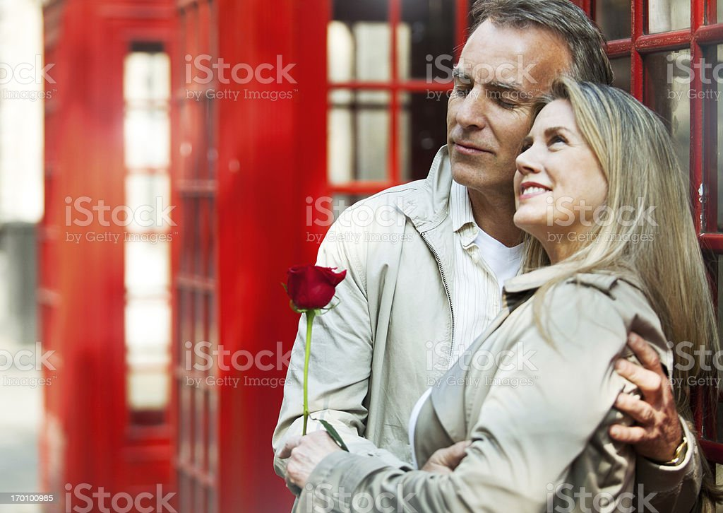 Happy mature couple embracing eachother and smiling. royalty-free stock photo