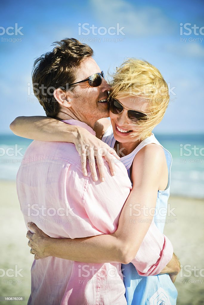 Happy Mature Couple embracing on the beach royalty-free stock photo