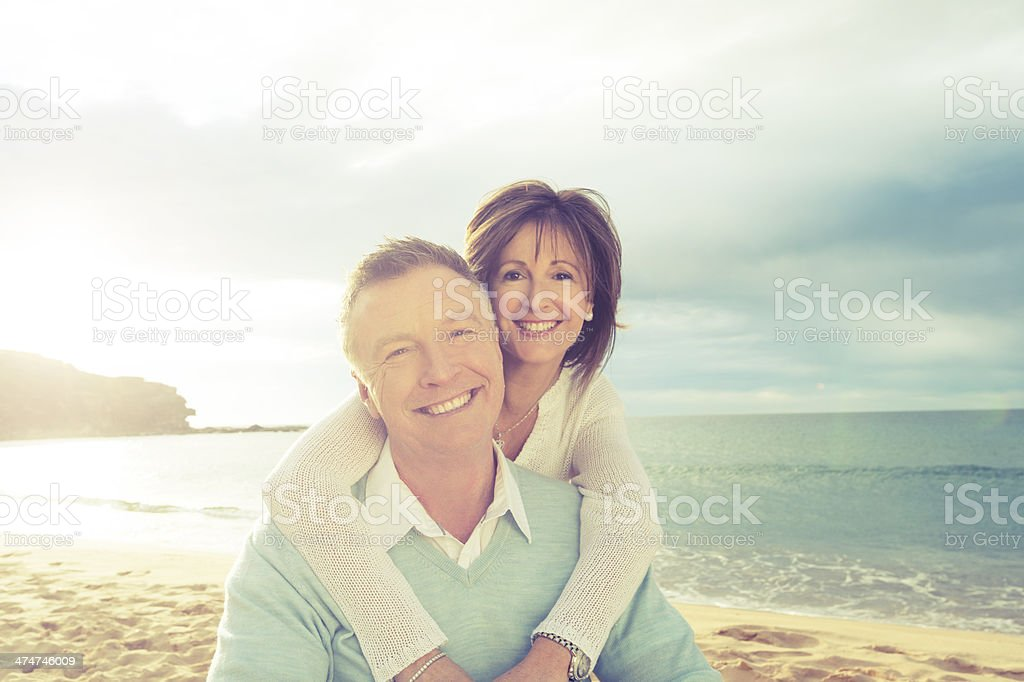 Happy mature couple embracing royalty-free stock photo