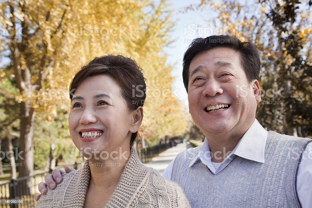 Happy Mature Couple Enjoying the Park in Autumn royalty-free stock photo