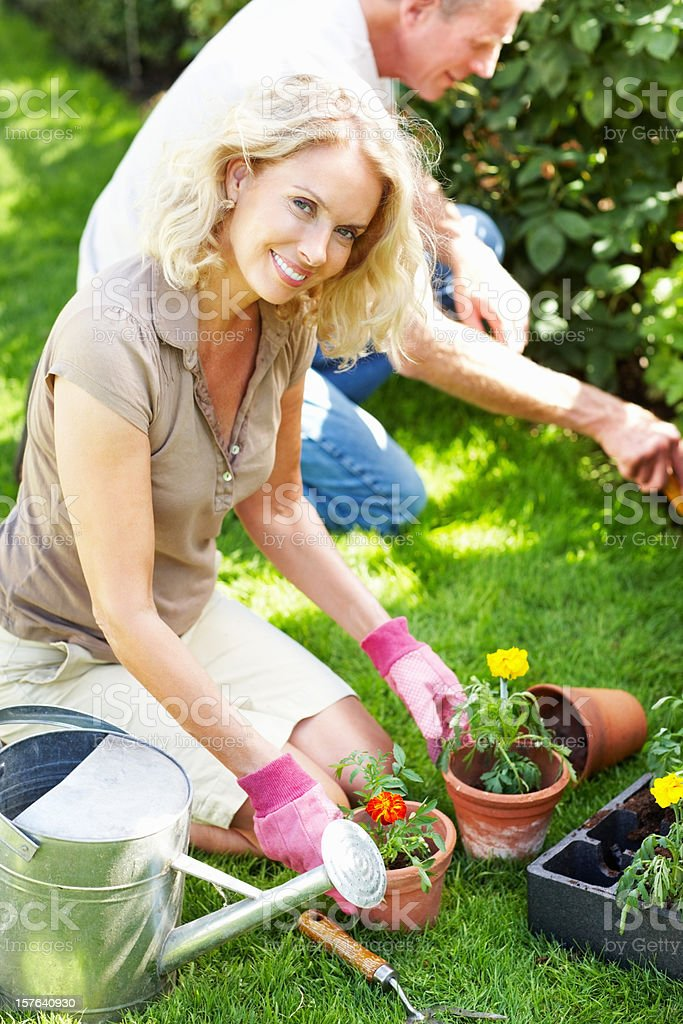 Happy mature couple gardening royalty-free stock photo