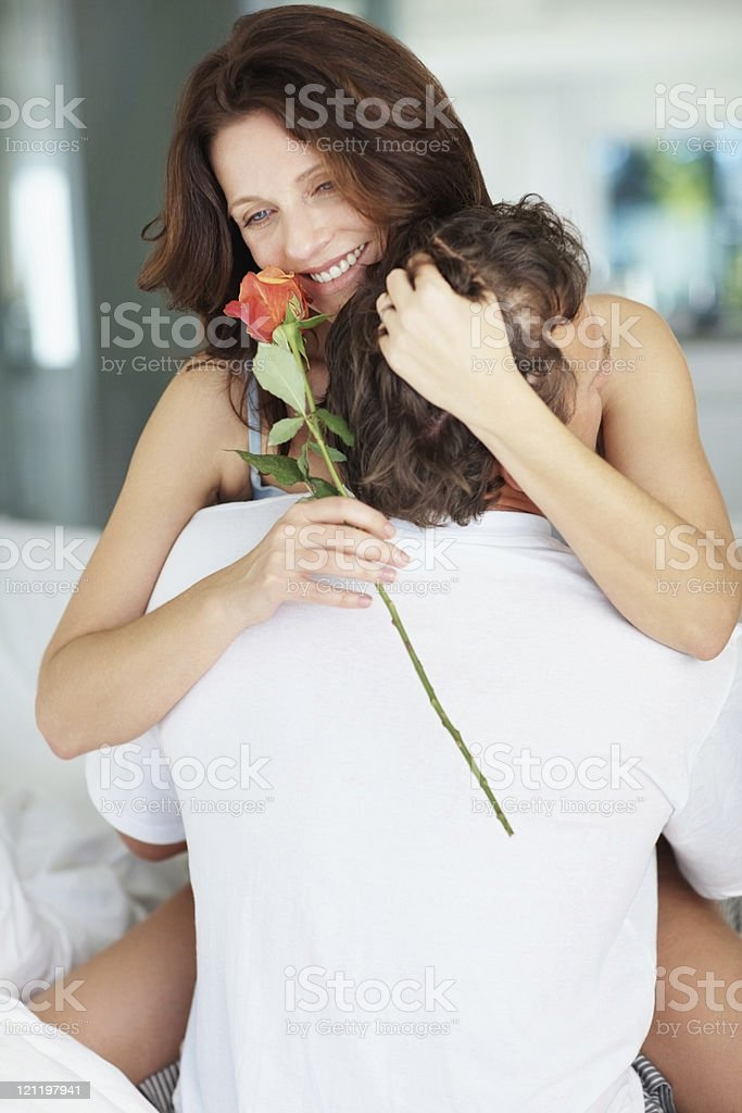 Happy mature couple getting intimate in bed royalty-free stock photo