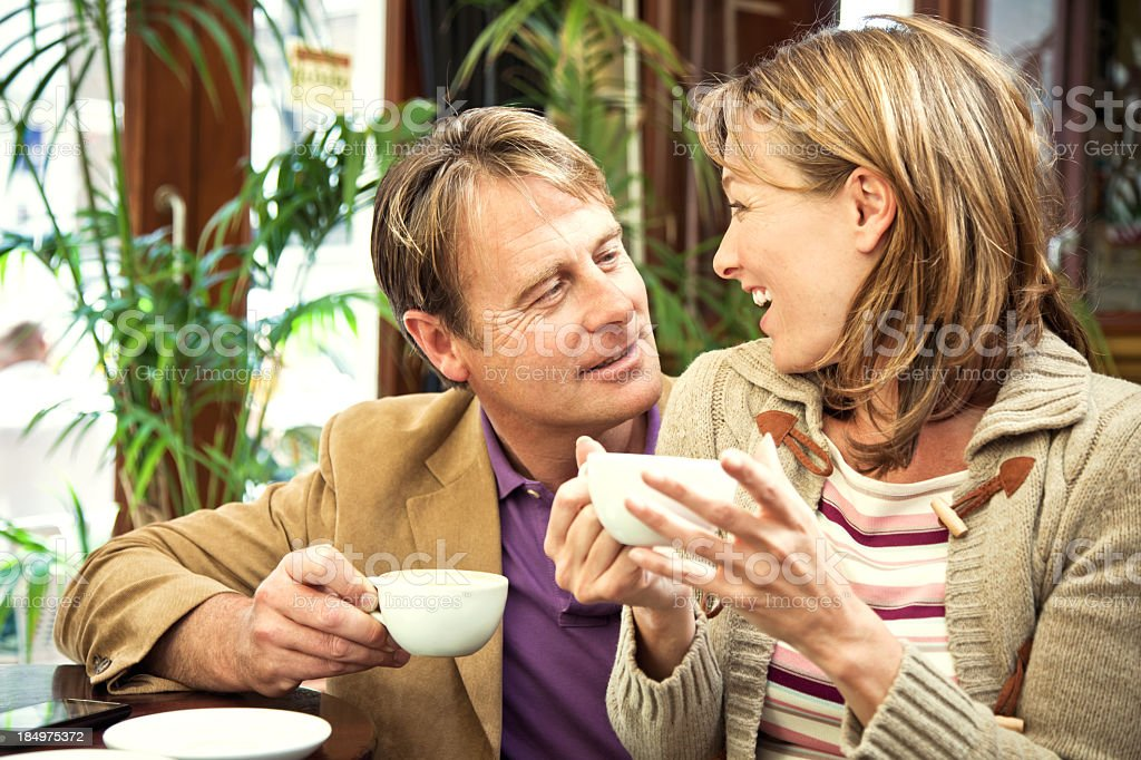 happy mature couple in a cafe royalty-free stock photo