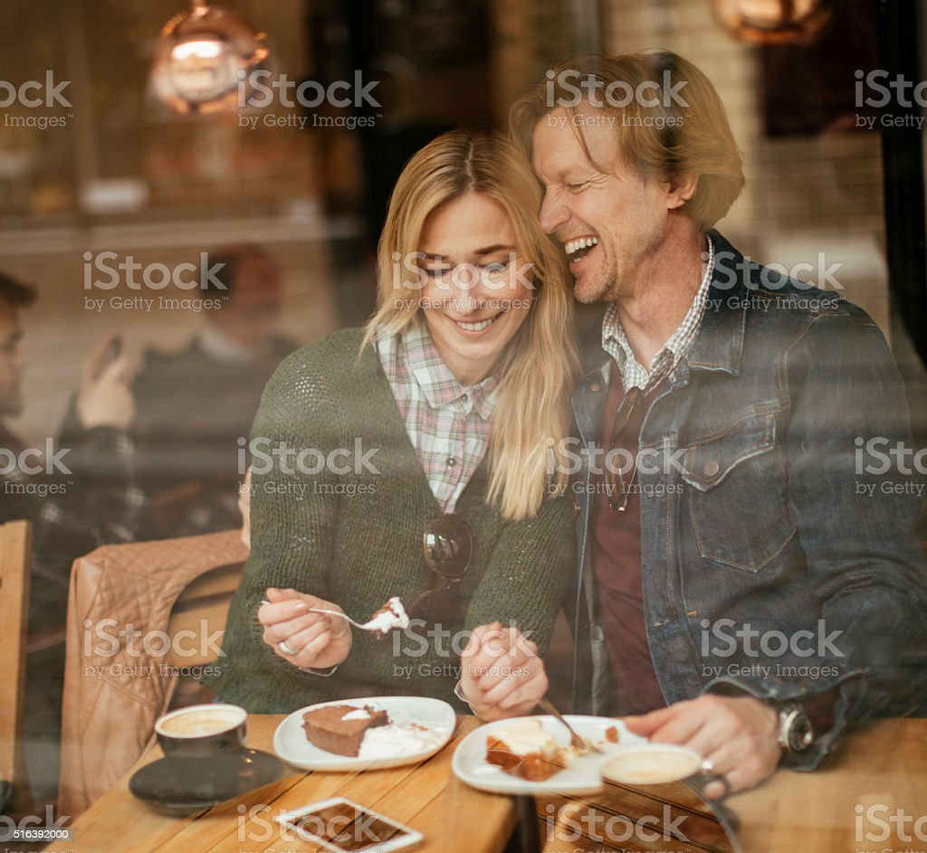 Happy mature couple in cafe stock photo
