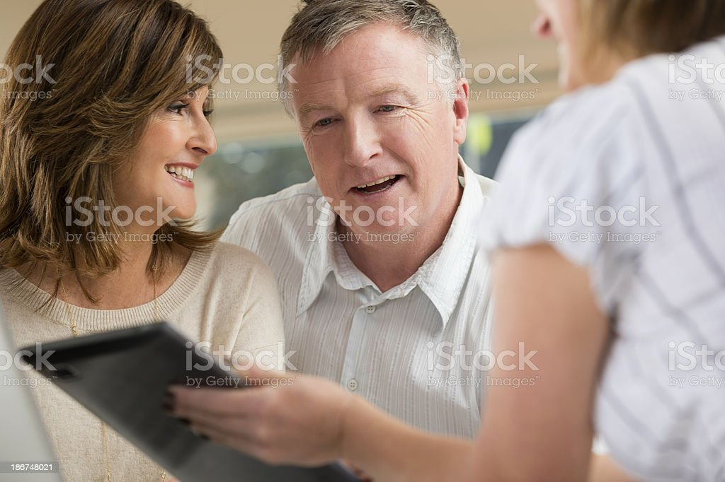 Happy mature Couple in Meeting With Advisor royalty-free stock photo