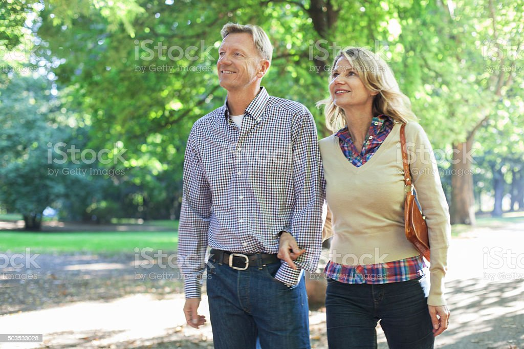 Happy mature couple in the park stock photo
