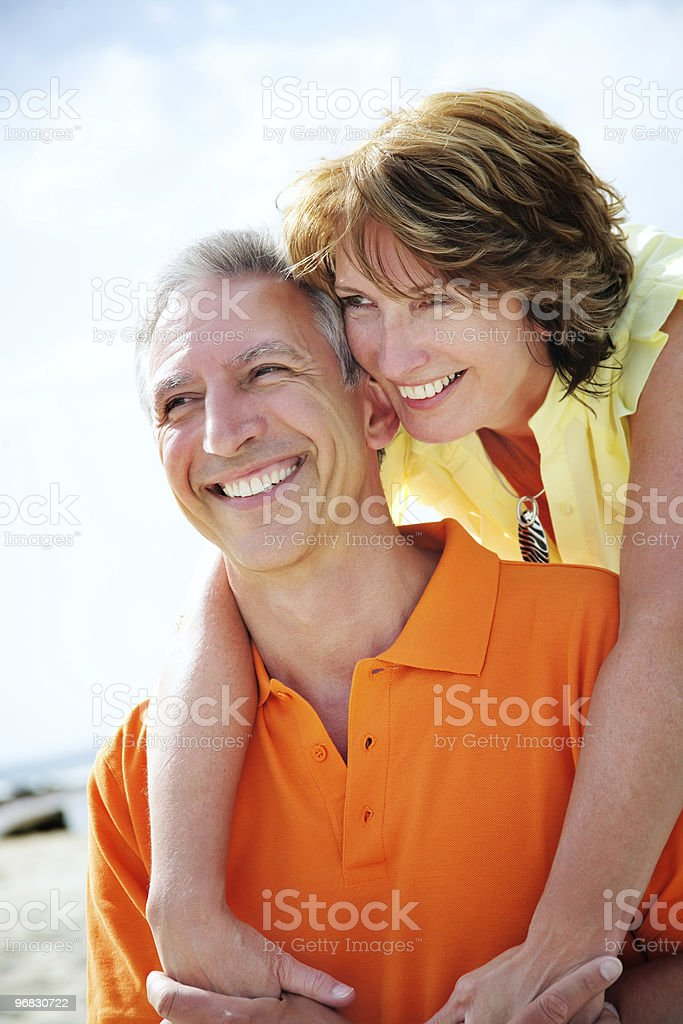 A happy mature couple on holiday royalty-free stock photo