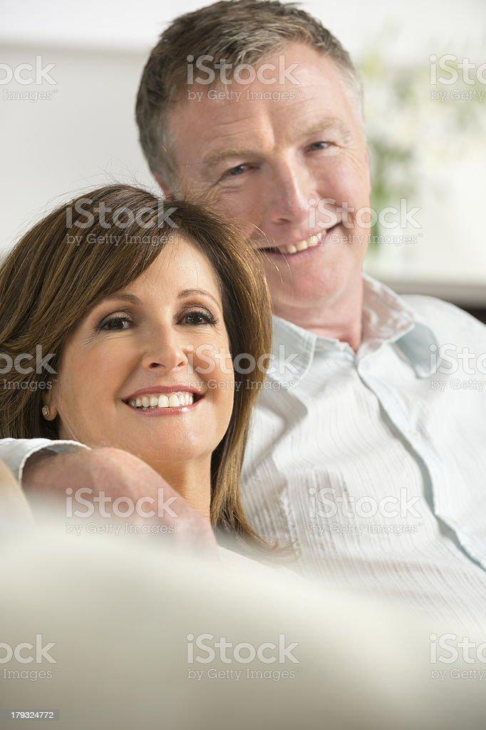 Happy mature couple on the sofa royalty-free stock photo