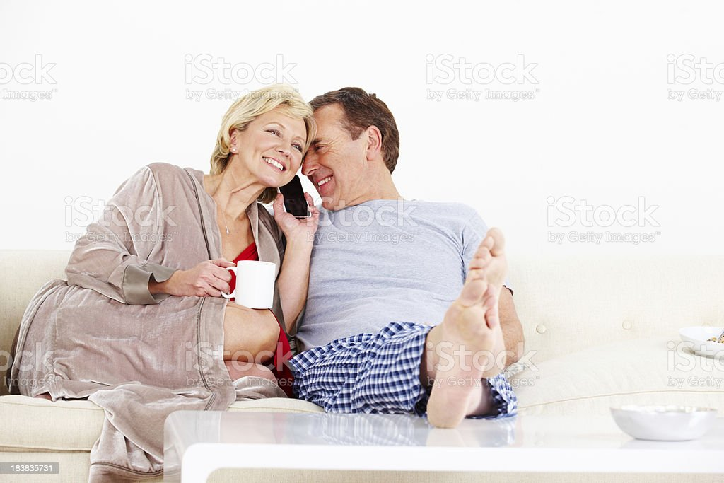 Happy mature couple on the telephone royalty-free stock photo