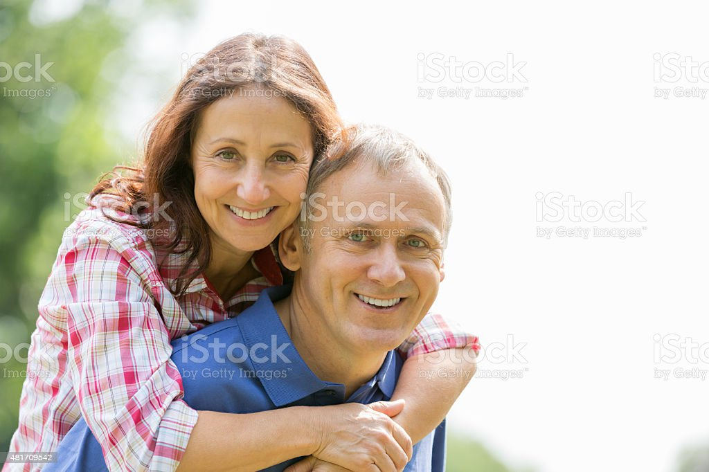 Happy mature couple outdoors stock photo