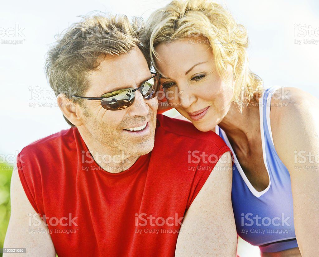 Happy Mature Couple Relaxing After Exercising Outdoors royalty-free stock photo