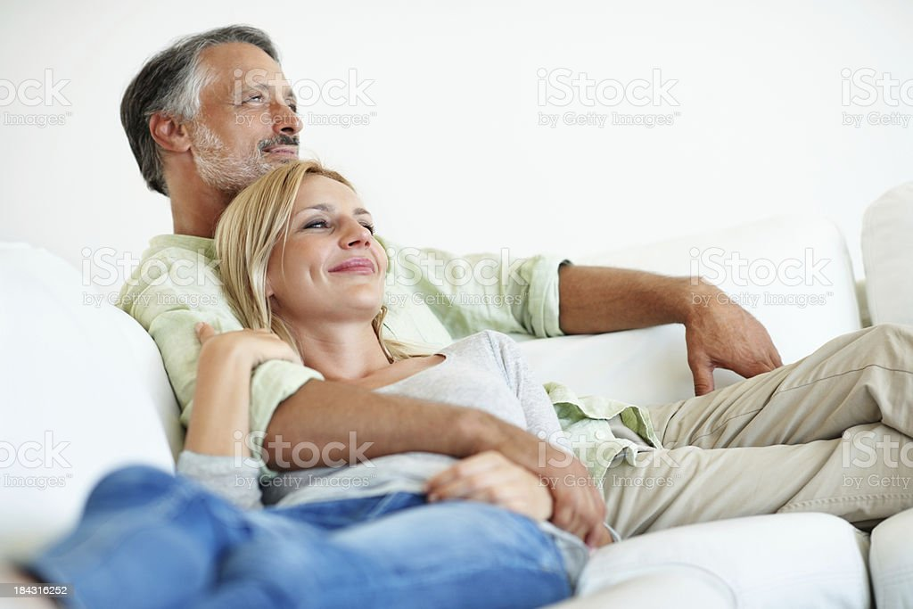 Happy mature couple resting together stock photo