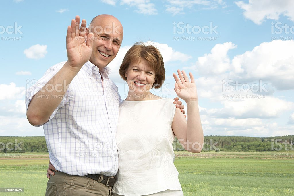 Happy mature couple smiling at camera royalty-free stock photo