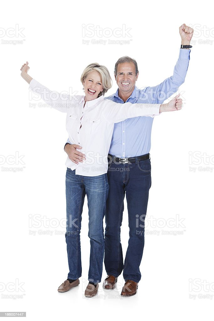 Happy mature couple standing with the arms up in victory royalty-free stock photo
