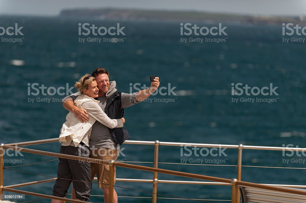 Happy Mature Couple Taking a Wefie at Outdoor stock photo