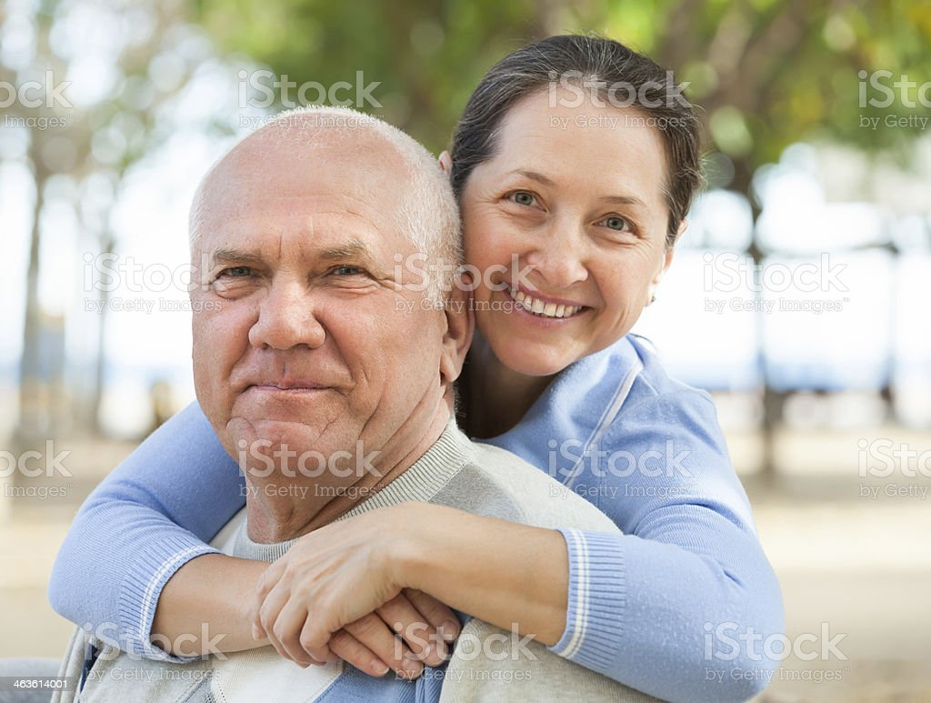 Happy mature couple together in autumn park stock photo