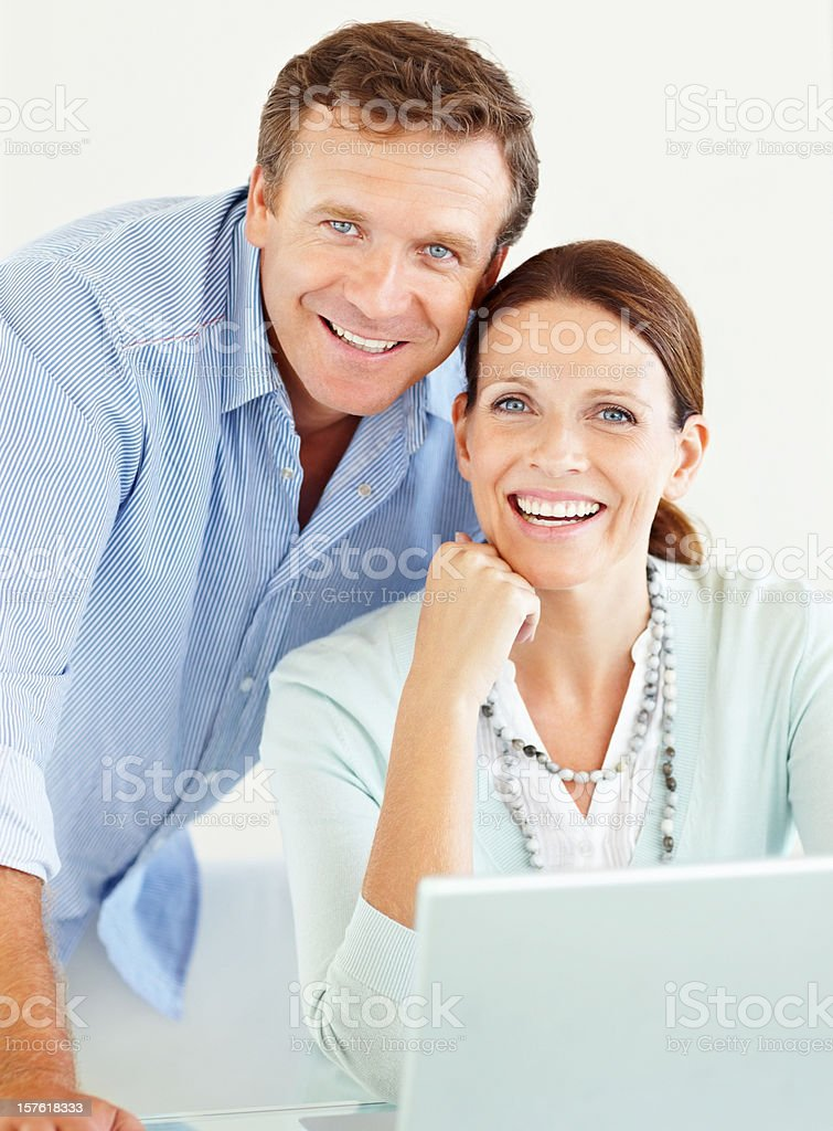 Happy mature couple using a laptop royalty-free stock photo