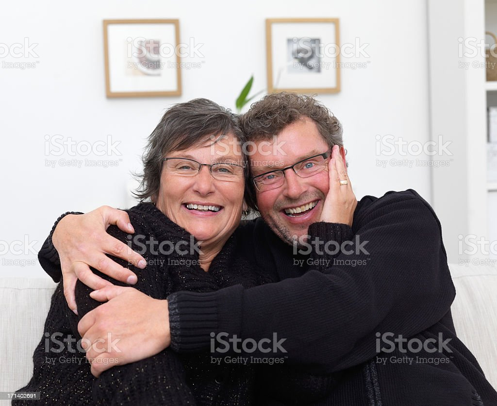 Happy mature couple with arms around each other royalty-free stock photo