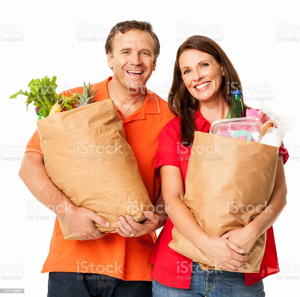 Happy Mature Couple With Grocery Shopping Bags - Isolated royalty-free stock photo