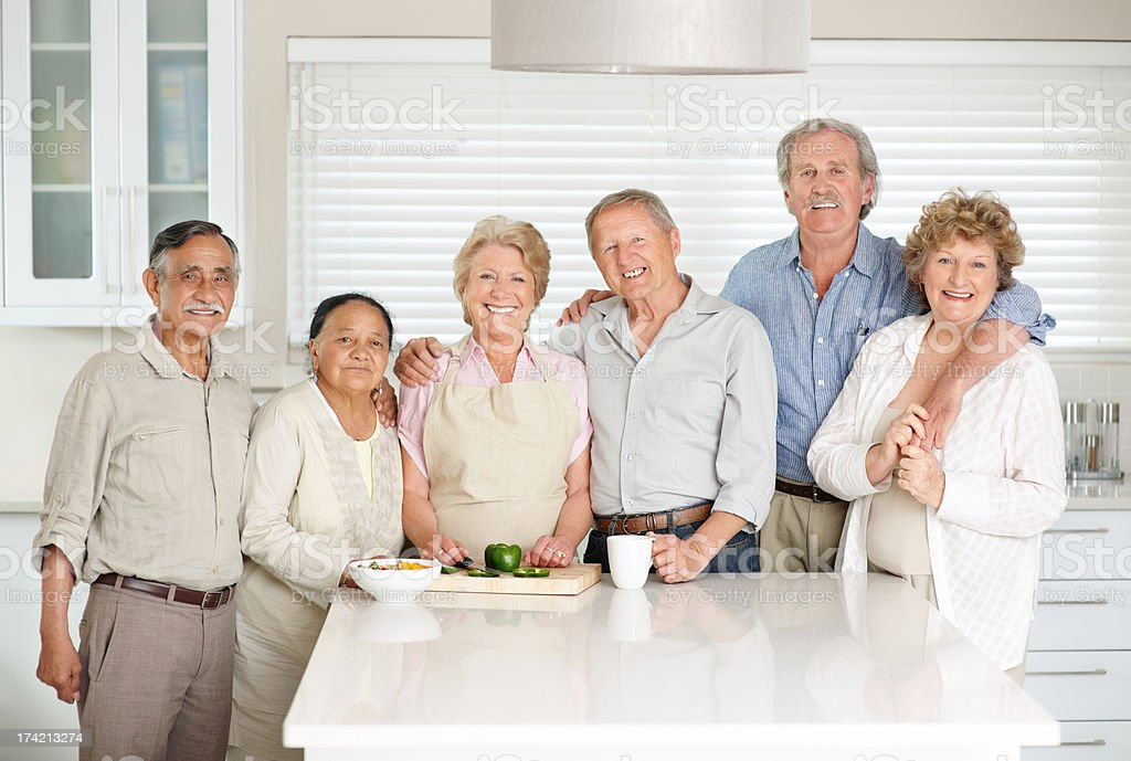 Happy mature couples standing together - Indoor stock photo