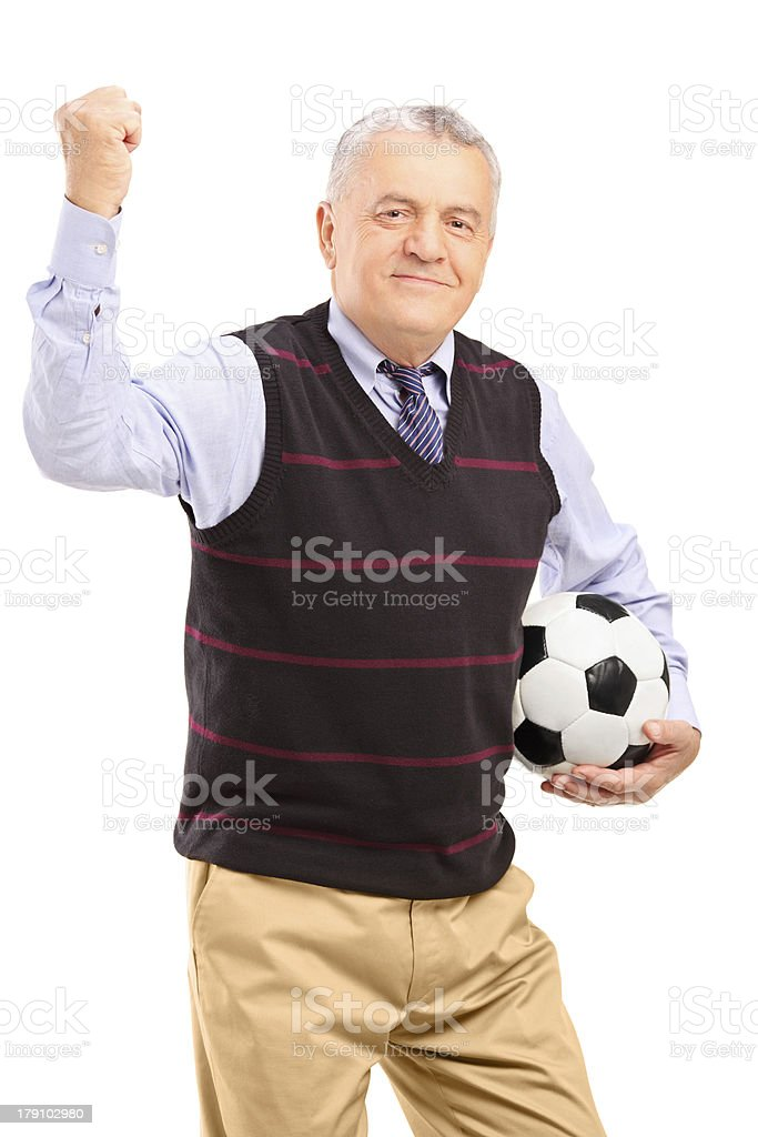 Happy mature fan with football gesturing royalty-free stock photo