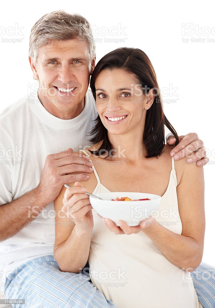 Happy mature lady having breakfast with her husband royalty-free stock photo