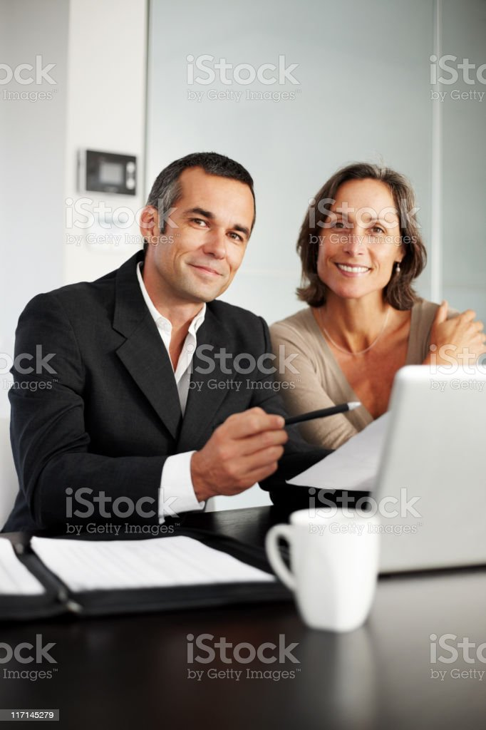 Happy, mature man and woman having a consultation royalty-free stock photo
