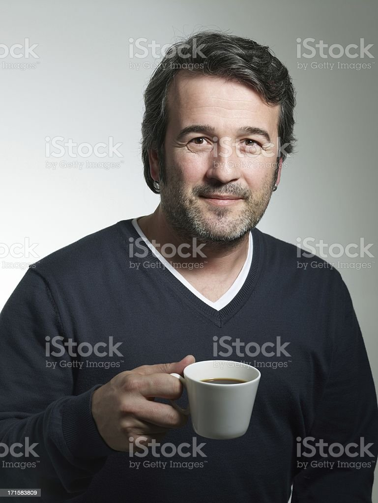 Happy mature man drinking coffee royalty-free stock photo