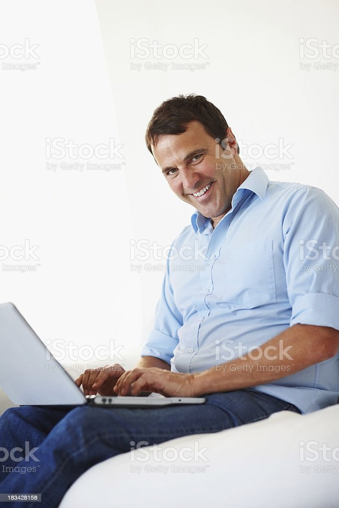 Happy mature man enjoying work royalty-free stock photo