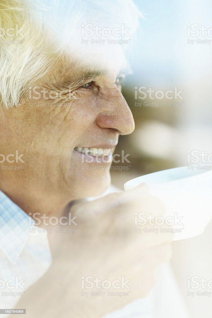 Happy, mature man having coffee stock photo