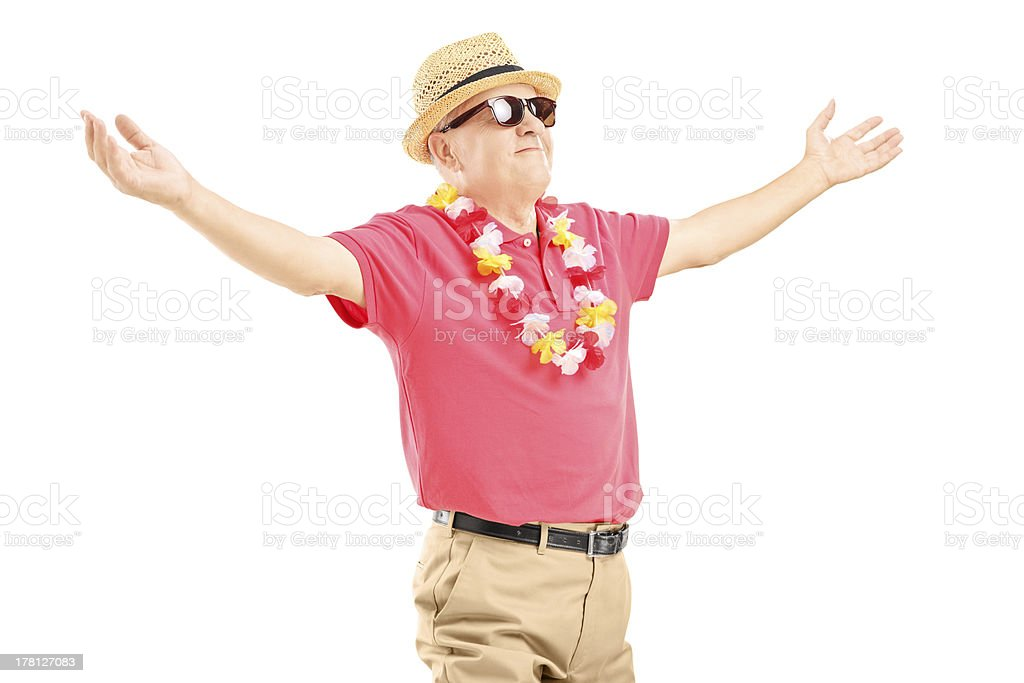Happy mature man on a vacation spreading his arms royalty-free stock photo