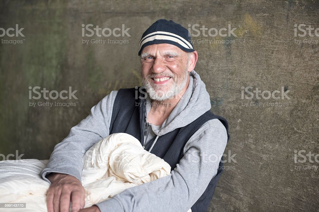 Happy mature man outdoors with a blanket stock photo