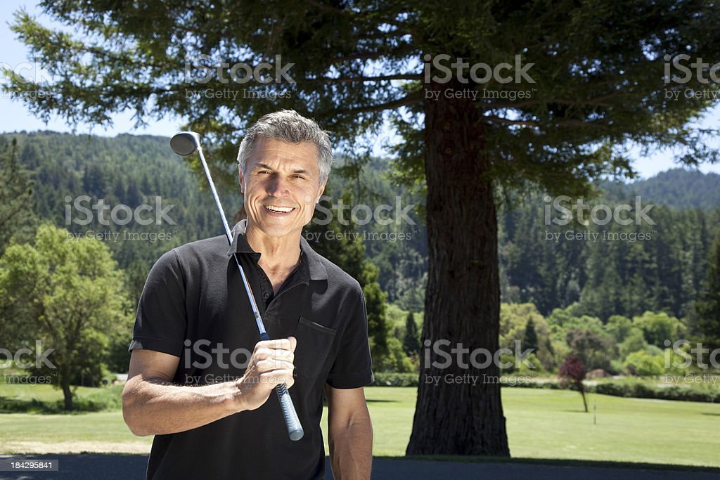 happy mature man with golf club royalty-free stock photo