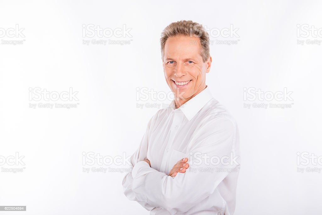 happy mature man with wrinkles and charming smile. stock photo