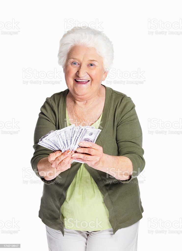 Happy mature woman holding dollars against white background stock photo