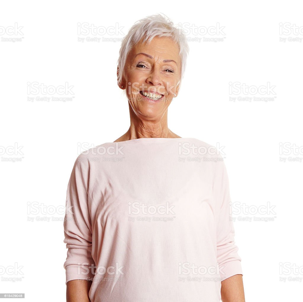 happy mature woman in her sixties stock photo