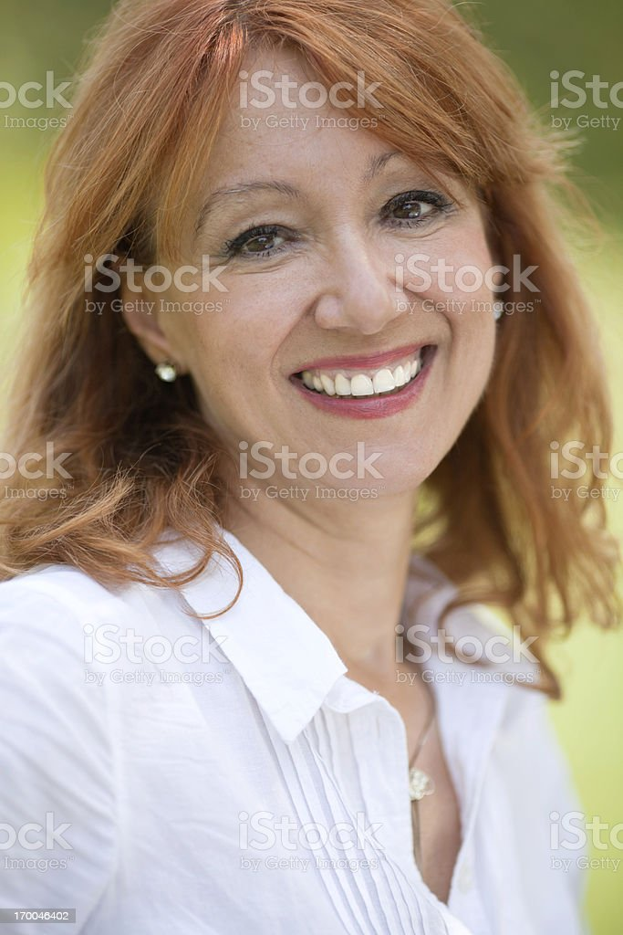 Happy mature woman outdoor royalty-free stock photo