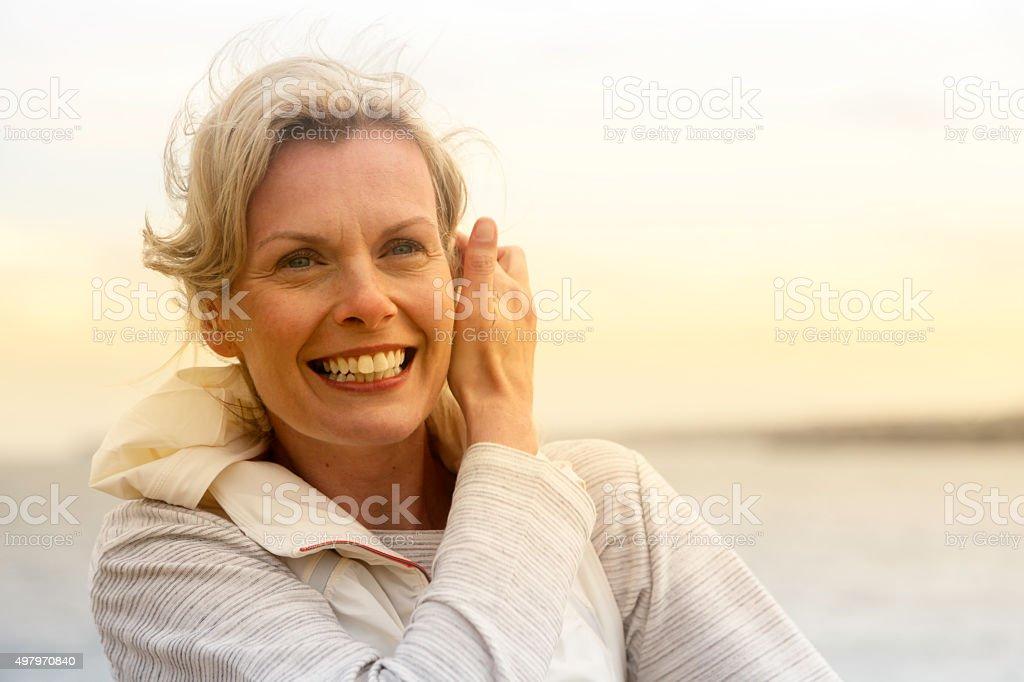 Happy mature woman stock photo