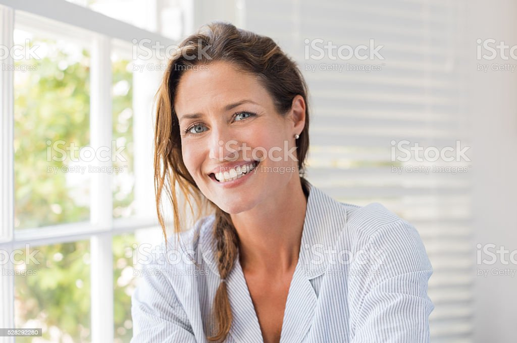 Happy mature woman stock photo