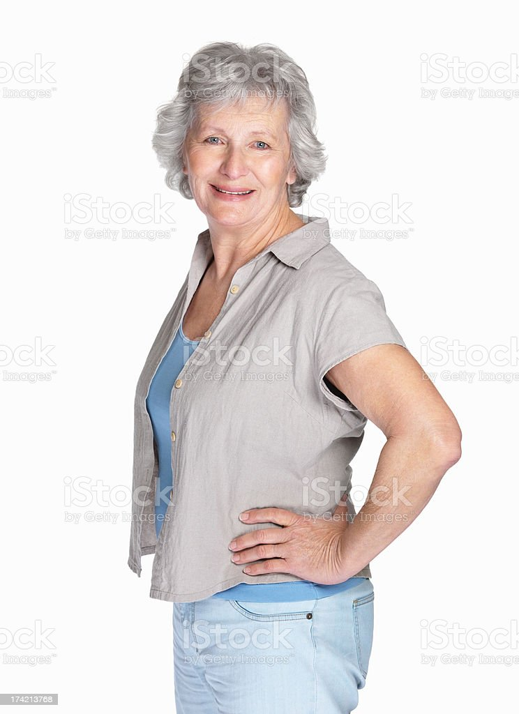 Happy mature woman posing against white background stock photo