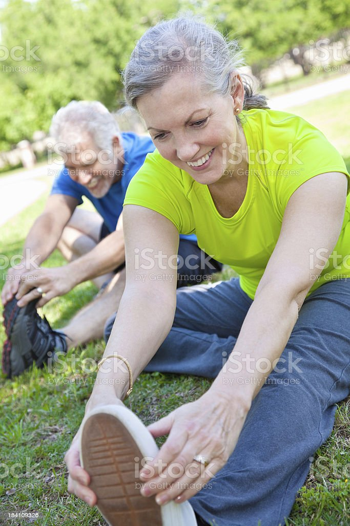 Happy Mature Woman Stretching Legs With Partner royalty-free stock photo
