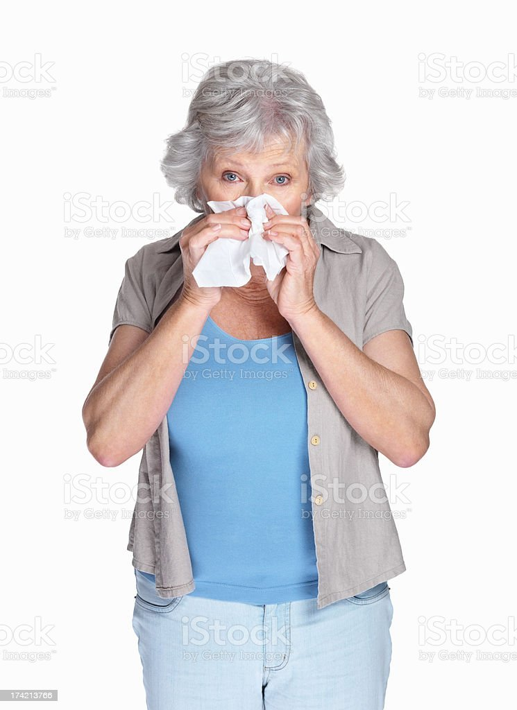 Happy mature woman with hands folded isolated against white stock photo