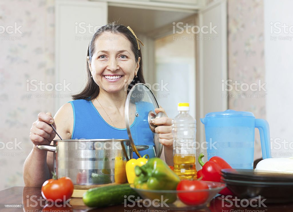 Happy mature woman with vegetables royalty-free stock photo