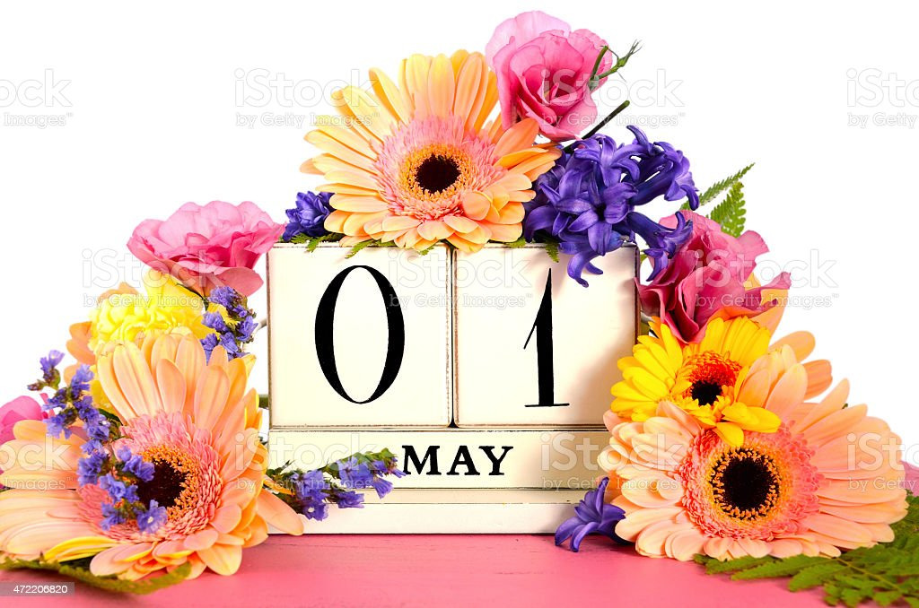 Happy May Day calendar with flowers. stock photo