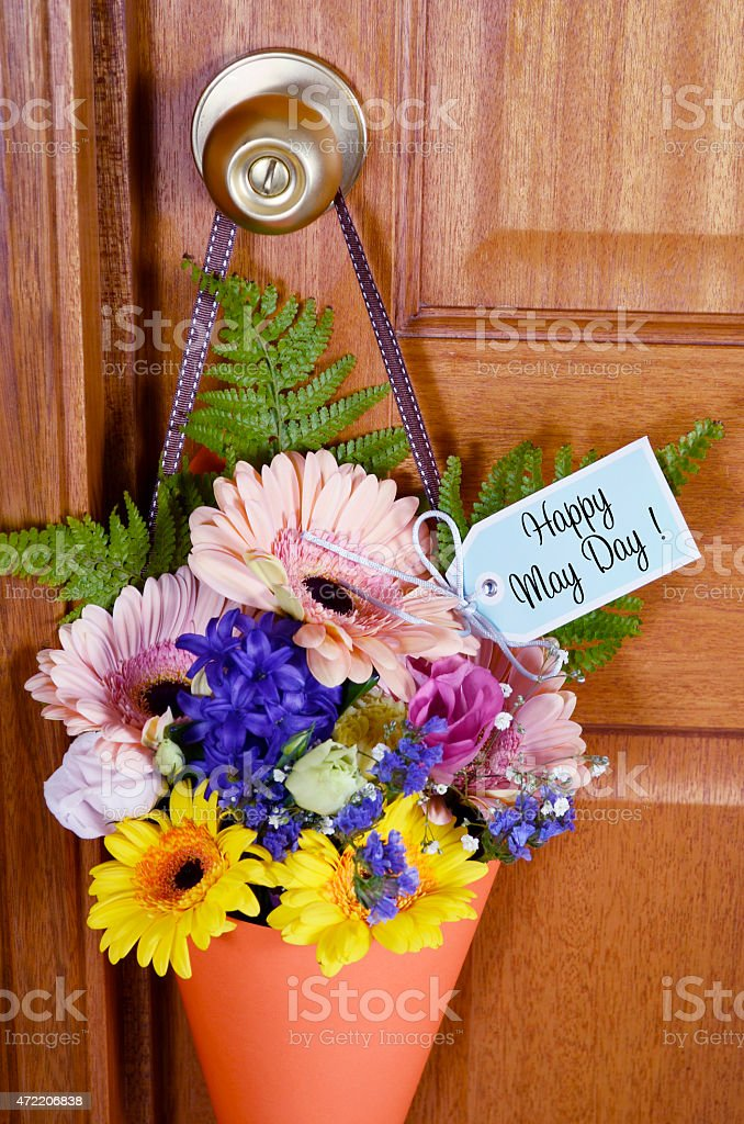 Happy May Day gift of flowers on door. stock photo